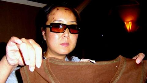 13年前访美被警察打伤 中国女子今获赔46万美元