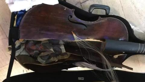 只剩琴弦在哭泣,350年古董大提琴托运后面目全非