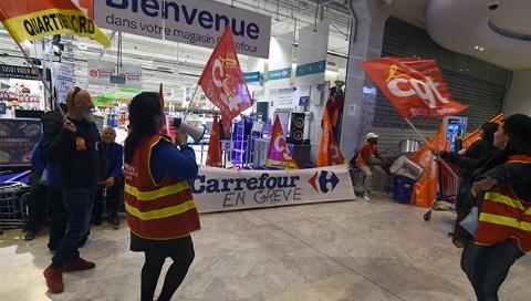 不满裁员和分红 法国近半数家乐福罢工