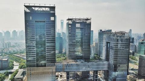 改革开放再出发 | 上海国际金融中心三幢塔楼初见雏形 计划2019年竣工