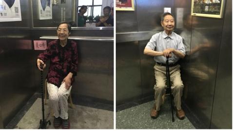 大楼电梯现温馨一幕:一把爱心椅暖人心