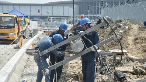 国家会展中心西大门108根电杆开拔 三线同时故障也能正常供电
