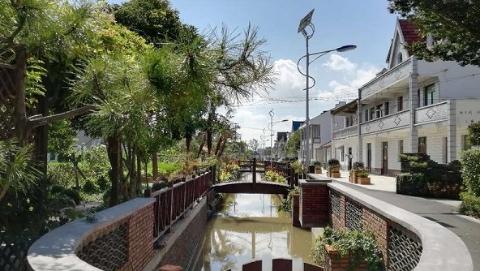浦东老港镇:自留地上建公园 家里开出服务点