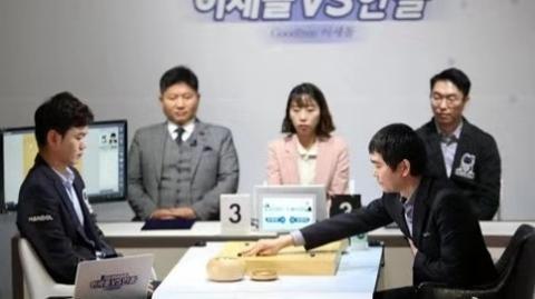 李世石九段退役赛今在首尔落子:首战执黑胜人工智能韩豆