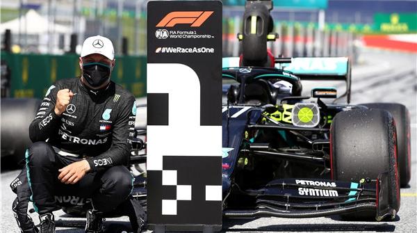 看台没有观众,围场没有嘉宾,但能恢复比赛的F1就很了不起!