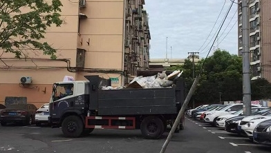 夏令热线丨门前垃圾已清运